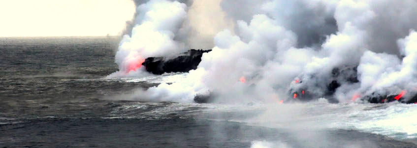 View of the lava entering the Pacific Ocean from a helicopter.