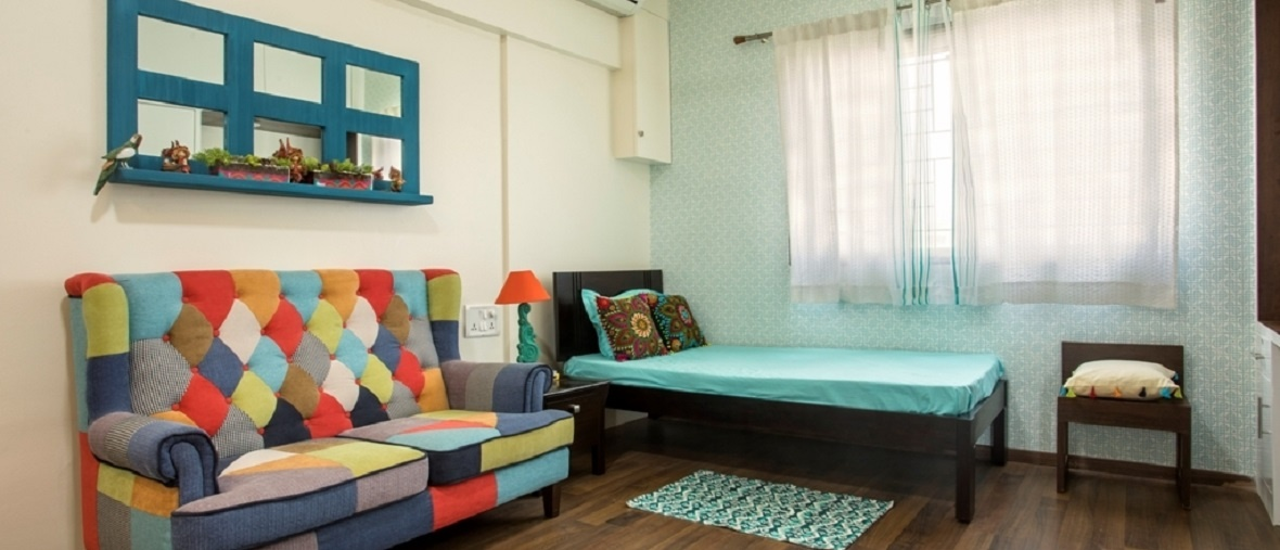 Multi-coloured couch Bedroom Interiors