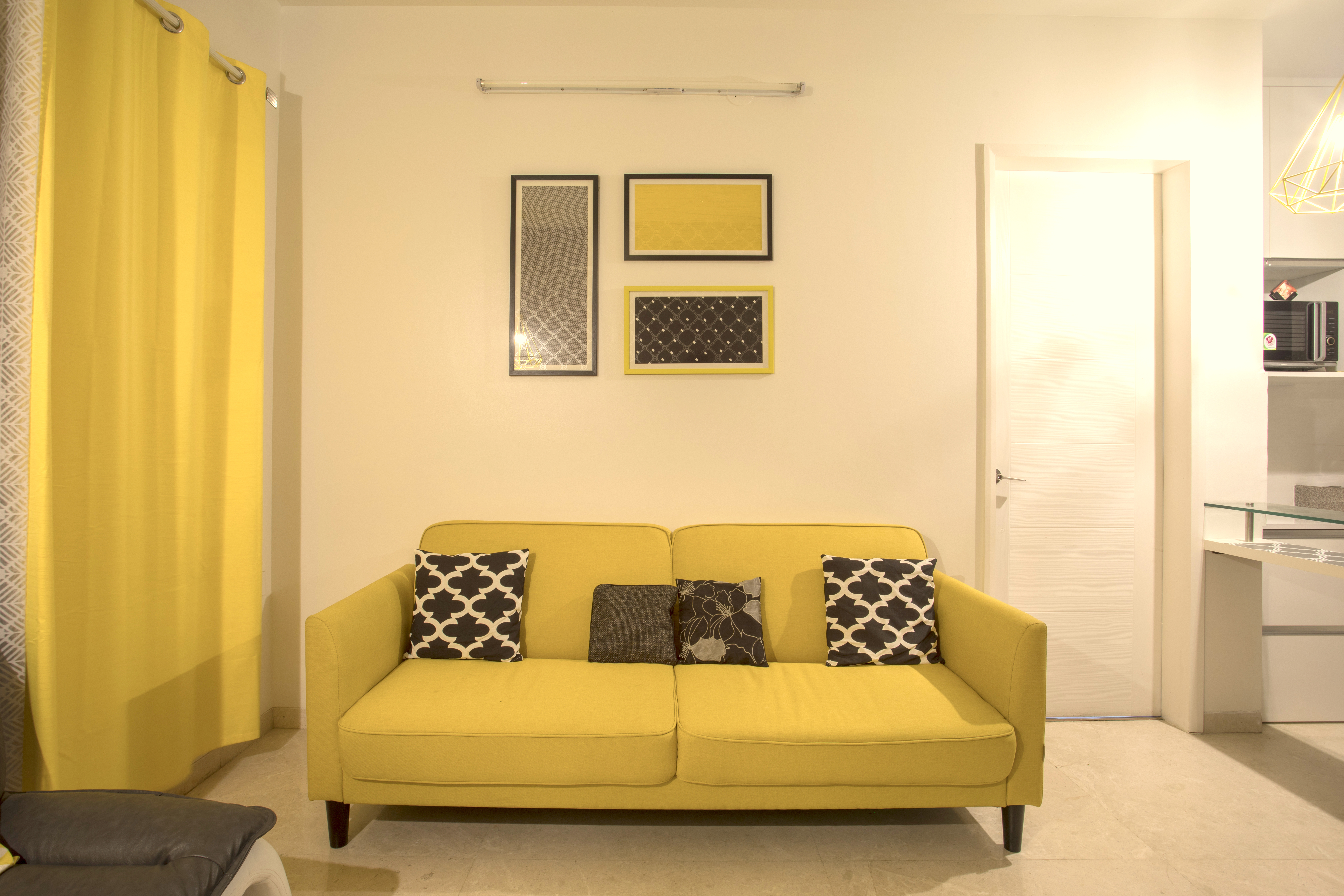 ... Integrate The Yellow Sofa Into The Living Room Without Making It Seem  Out Of Place. The Accent Pillows Are Quirky And Fun And They Combine Well  With The ...
